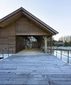 renowned architect bernard desmoulin completes the humble conference room at the moulin de la forge, located on a lake in the french region of vexin.