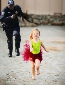 little girl running from the police.  too funny:D