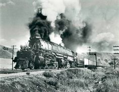 One of UP's Big Boy locomotives hauling a freight train through Echo Canyon, Utah.