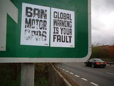 """Ban motor cars. Global warming is your fault"" - fly posters on M32 motorway, Bristol, UK (2003)"
