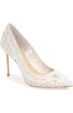 In love with these luxe pointy toe pumps with semi-opaque mesh and macramé detailing for a chic look.