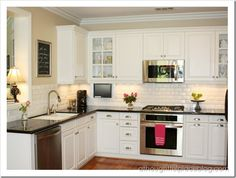 white cabinets light yellow walls.  I want to find a color like this.