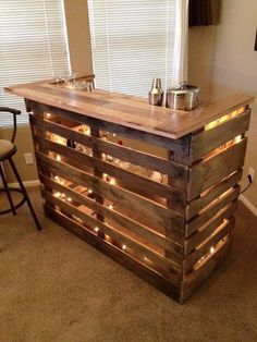 Decorate your Home Bar on a budget with this DIY Pallet Bar #mancave Micoleys picks for #DecorInspiration www.Micoley.com