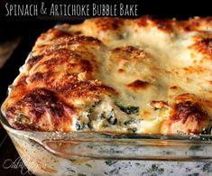 Spinach & Artichoke Bubble Bake from @Amy @Ohbiteit.com. Replace the sour cream w/ plain Greek yogurt!