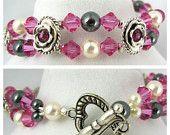 Cream Swarovski Pearls and Sodalite bracelet. $10.00, via Etsy.