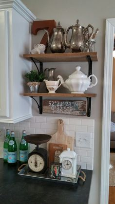 My husband helped me make this open shelving from reclaimed barnwood. I love being able to incorporate this old wood in my kitchen.
