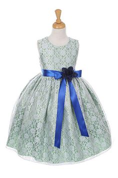 The perfect dress for her special day, this dress is so stylish. The dress is made in beautiful floral lace and the waist line is accented with an adorable bow. The skirt on this dress has the perfect amount of fullness. Comes in endless removable satin sash and pin on flower color options! The dress is fully lined for complete coverage to ensure that your princess stays comfortable. Zipper closure. Do not miss out on this dress! Proudly made in the USA. This dress is pictured with an…