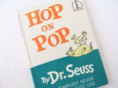 This vintage Dr. Seuss book, Hop on Pop, an I Can Read It All By Myself Beginner Book, features rhymes! It has rhymes like pup on cup, cup on pup.