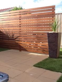 Merbau screen used to hide spa pool pumb and filter. Paving and artificial turf. Done by Exseed Landscaping in Deer Park.