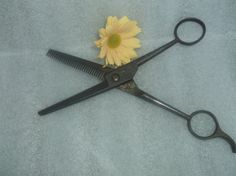 Check out this item in my Etsy shop https://www.etsy.com/listing/242072378/vintage-barber-scissors-thinit-made-in