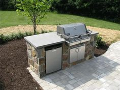 simple and easy with a wood frame and stone covering - Patio Kitchen