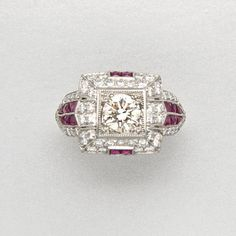 PLATINUM, DIAMOND AND RUBY RING 1 and 58 diamonds approx 0.65 & 0.70 ct