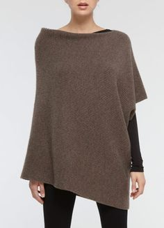 Now that's a poncho I would wear.  Now I just need about 40+ hours to knit it...
