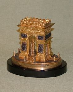 A small mid 19th Century well-cast bronze & ormolu Model of the Arc de Triomphe, having lift-up lid raised on oval black marble platform plinth base.  Circa: 1860