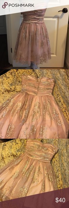 """Glitzy strapless dress for Homecoming Peachy colored with mesh overlay with roses gold glitter pattern on mesh.  Measures 25"""" from top to bottom, about 26""""around at bust and about 24"""" a little above waist before it flares. Delia's Dresses Strapless"""