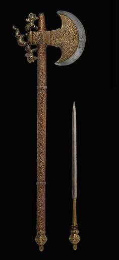 TABAR, Battle Axe with dagger - 19th century  Northern India  Steel, copper, brass. From The Caravana Collection, www.caravanacollection.com
