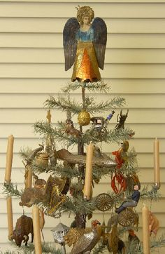 Early American Feather Christmas Tree ~ Primitive tree with vintage angel topper, antique bird and toy ornaments with real candles.