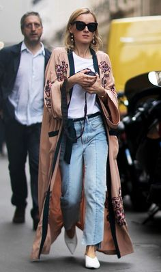 An Editorial Eclectic gal loves the unexpected.  The Street Style Trend That's All Over Paris via /WhoWhatWear/ : white tee shirt, silk robe over jeans