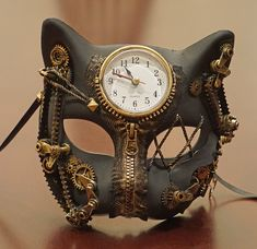 Cronos Steampunk Cat Mask Steampunk Masks Cronos Steampunk cat mask is hand painted and accented with clock and gears. The mask is made of a durable non bendable PVC and has a working clock. This steampunk mask is available in gold, silver ,and Chat Steampunk, Mode Steampunk, Style Steampunk, Steampunk Clothing, Steampunk Fashion, Victorian Steampunk, Steampunk Cosplay, Steampunk Design, Steampunk Gas Mask