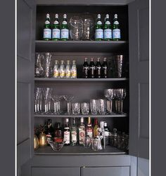 I would love to do something like this so we could display all our barware and free up some kitchen cabinet space! I'm feeling it in green or yellow with cute paper on the inside:-)
