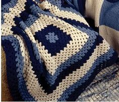 Crocheted Granny Lapghan...this. Looks cool, but I want to try it just to see if I can follow the directions