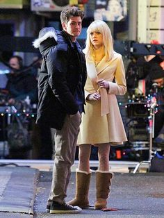 Spidey sense, anyone? Andrew Garfield and a wigged-out Emma Stone spot some snappers while filming scenes for The Amazing Spider-Man 2  in N.Y.C.'s Chinatown. http://www.people.com/people/gallery/0,,20678682,00.html#21289756