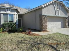 9657 Darley Way, Elk Grove, CA 95757 — HURRY!!! A Backer Ranch Home, New laminate flooring,open design with a great room concept,Corian Kitchen counter tops, built in entertanment center. Close to shopping and parks. Low mantinance landscape. Won't last long. A MUST SEE.