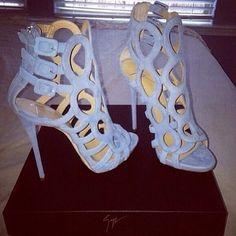 White buckled heels