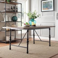 Pretty close to perfect! The spindle reminiscent metal legs bring just enough of a touch of classic design to pair with upholstered nailhead trim chairs. As long as chair leg stain matches table top stain.