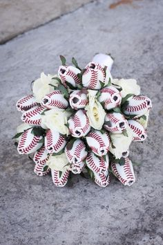 Baseball Rose Bouquet! Cute idea for the rehearsal dinner or something, not the actual bouquet