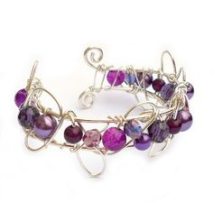 "Small Cuff Bracelet - Purple  £22.00  Handmade wire cuff bracelet made with silver plated (non-tarnish) wire with various purple glass pearls and beads. Size: Fits 6.5"" - 7.5""."