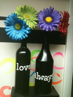 spray painted wine/liquor bottles. only two coats with krylon fusion for plastic.