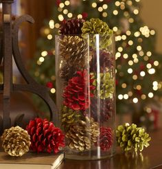 DECORATING AROUND THE HOUSE with colored pine cones Pine Cone Decorations, Christmas Decorations, Table Decorations, Holiday Decor, Diy Decoration, Green Christmas, Christmas Tree, Xmas, Large Glass Vase