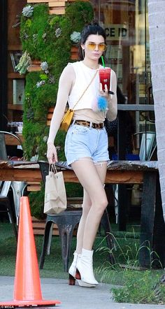 Kendall Jenner goes bare-legged in tiny denim shorts in Beverly Hills #dailymail