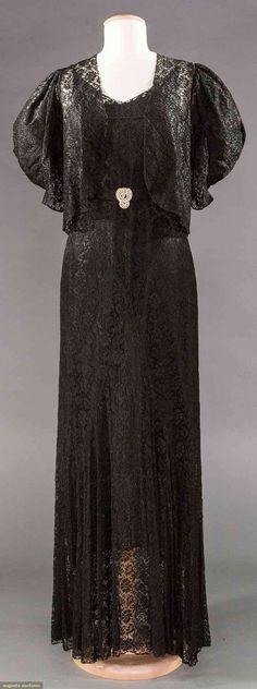 "1930s Black bias cut evening gown, all lace w/ matching short jacket, lace belt & original silk slip, B to 33"", W 28"", H 36"", L 59"""