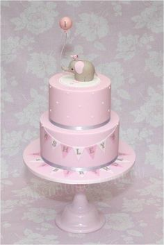 This cake is based on my original Baby Elephant Cake but in Pink, White and Grey colours, for a little girl's 1st Birthday. The Baby Elephant figurine is made to match the cute Invitations and Party Printables designed by Sarah from...