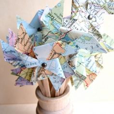 Handmade Atlas map pinwheels are ideal as cake toppers, decor, name place settings or even as a garland! {Magpie & Max}