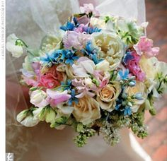 One North Carolina bride chose a stunning bouquet of sweet peas, hydrangea, tweedia, and open garden roses in breathtaking colors for her wedding.
