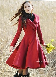 Absolutely love the rich red shade and the swirl of this coat. Perfect for the fall and early winter!