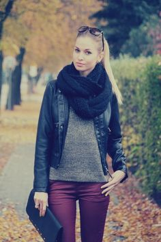 Tight pony tail, black knit infinity scarf, black leather jacket, grey sweater, deep maroon pant, black leather clutch.