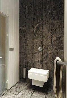 De grandes dalles de pierre donne à ces wc un style très zen