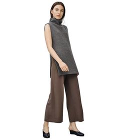 This tunic-style chunky knit balances the proportion of cropped pants and is one of the most wearable trends for fall. Surprisingly flattering with slim pencil pants, it works just as well with flats as it does with heels.