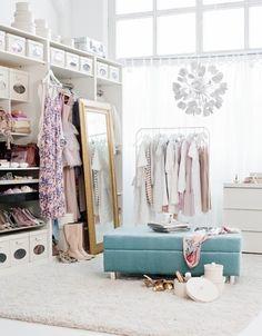 A massive walk in wardrobe, I love the white it's so beautiful!