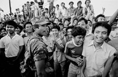 """1986 Philippine Revolution Revisited: People Power"""" participants joke with Marcos troops outside Camp Aguinaldo. The non-confrontational approach limited military response and led to an almost bloodless coup. People Power Revolution, Power To The People, Troops, Martial, 30th, Law, Survival, Anniversary, Military"""