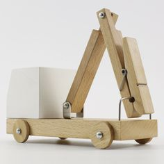 Poor Toys by Poorex combine simplified wooden vehicles with household items such as a brush, a plug and a clothes peg.