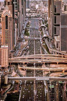 Sheikh Zayed Road running through the heart of Dubai, United Arab Emirates. Photo by Sebastian M Abu Dhabi, Places Around The World, Around The Worlds, Beautiful World, Beautiful Places, Beautiful Pictures, Voyage Dubai, Magic Places, Dubai City