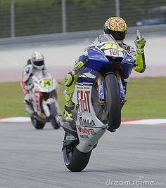 Sepang, Malaysia - October 18, 2008: Italian Valentino Rossi of Fiat Yamaha Team does a wheelie at 2008 Polini Malaysian Motorcycle Grand Prix Sepang Circuit Malaysia.