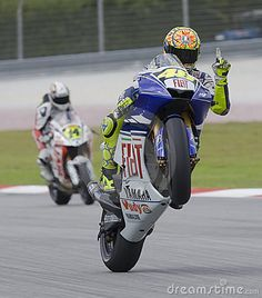 Sepang, Malaysia - October 18, 2008: Italian Valentino Rossi of Fiat Yamaha Team does a wheelie at 2008 Polini Malaysian Motorcycle Grand Prix Sepang Circuit Malaysia.