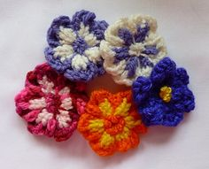 These flowers were originally designed for the Knifty Knitter 12 peg Flower Loom, but could be adapted to any small round loom. Leaves and a pin backing were added to the larger flowers and given as Mother's Day gifts.