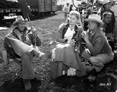 "Elaine Stewart with James Stewart and director James Neilson on the location for ""Night Passage"" (1957)"